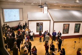 """Guests gather for the opening of """"Let the Church Say Amen: Rocky Fork Church in Voice and Vision,"""" a 2014 multi-media exhibit featured in Lewis and Clark Community College's Hatheway Cultural Center Gallery."""