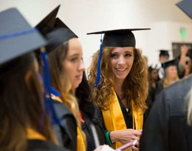 An honors student prepares to walk in Lewis and Clark Community College's annual Commencement ceremony.