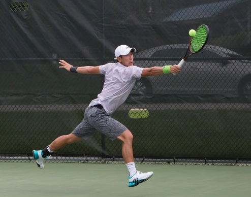 Jonathan Chang competes in the main draw of the 19th Annual Lewis and Clark Men's Pro Tennis Classic, Wednesday, July 20, 2016 after a late start due to rain.