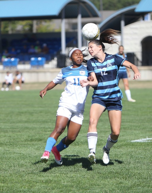 Trailblazer Senate Letsie fights for control of the ball during a game against St. Louis Community College in Fall 2017.